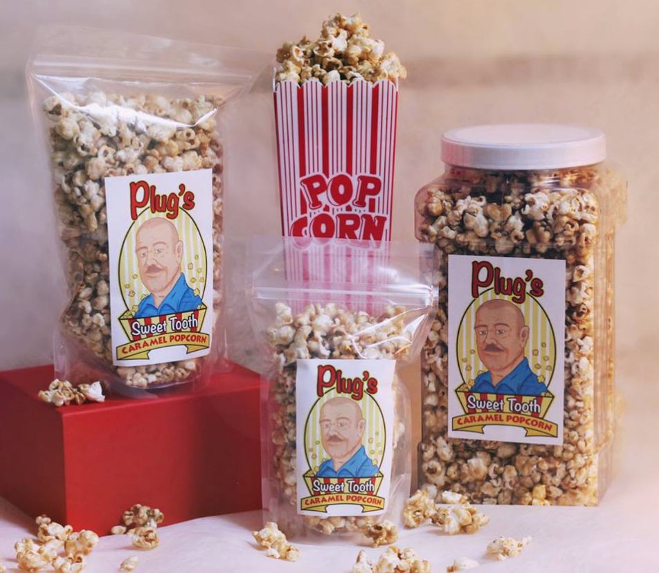 PLUG'S SWEET TOOTH - Plug's Sweet Tooth was launched by founders Pam and Dave Miles in Aurora, Indiana.Their products have small town roots and worldwide appeal!The caramel popcorn is an old family recipe that Pam has been making and sharing with friends and family for years. Of course, you can't leave good caramel popcorn all alone, so they developed some other terrific flavors to accompany it.