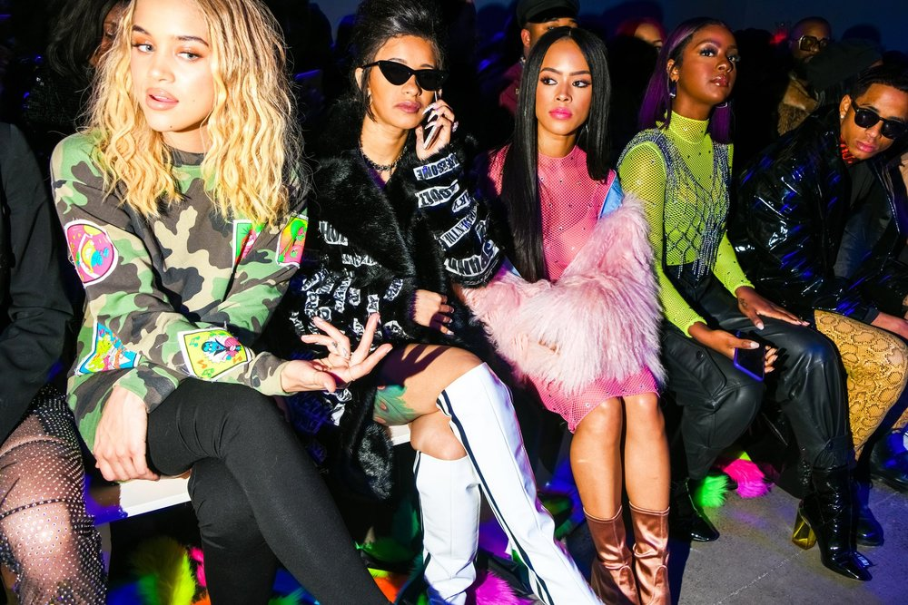 Cardi B (on phone) in the front row at the Jeremy Scott show during New York Fashion Week  Credit: Dolly Faibyshev for The New York Times
