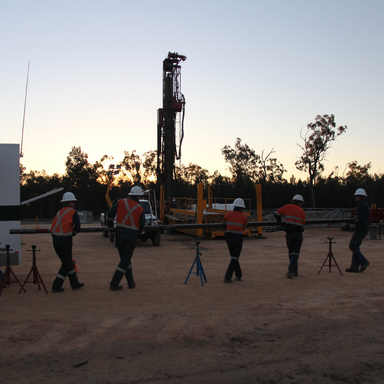 Drill Stem Testing Farley Riggs team on site at dusk Australia