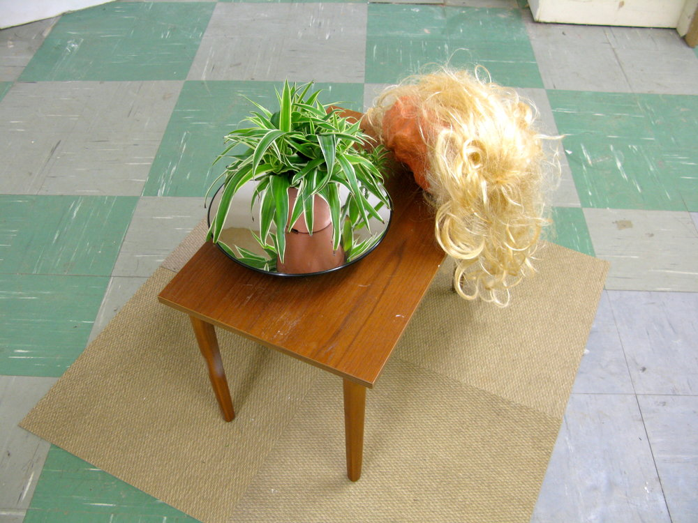Natural Beauty, 2017  Moving Sculpture  Found Objects, Spider Plant, Mirrored Turntable, Plaster, Synthetic hair