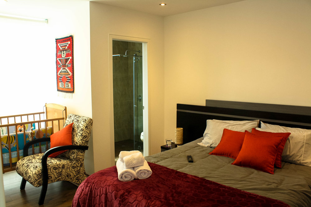 BEGONIA SUITE FOR 4 / Starting at $105 per night (breakfast included) - With a king size bed,  a queen size sofa cama that fit up to four people, It features a dinette set for working or eating, having some fun with table games.Special Ecuadorian Breakfast served each mornig.