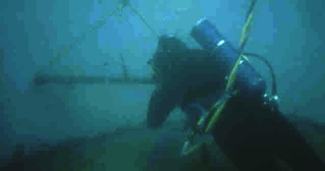 In this exercise, the diver's faceplate is blacked out with duct tape. The diver must tie four knots, a bowline, figure eight, sheet bend and square knot onto the bar by feel alone.