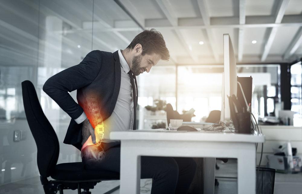back pain at desk.jpg