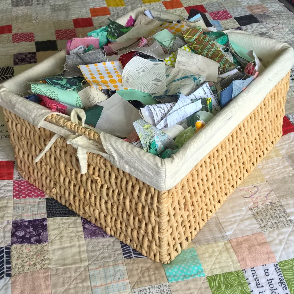 "My scrap basket dedicated to 2.5"" squares. Basket measures 14""x12""x7"" and no matter how many scrap projects I do, I feel like a barely make a dent in this pile!"