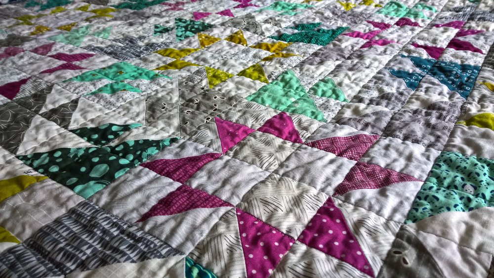 Up close and personal with the quilting! I stitched in the ditch in a 2-inch grid. The texture and drape is divine!