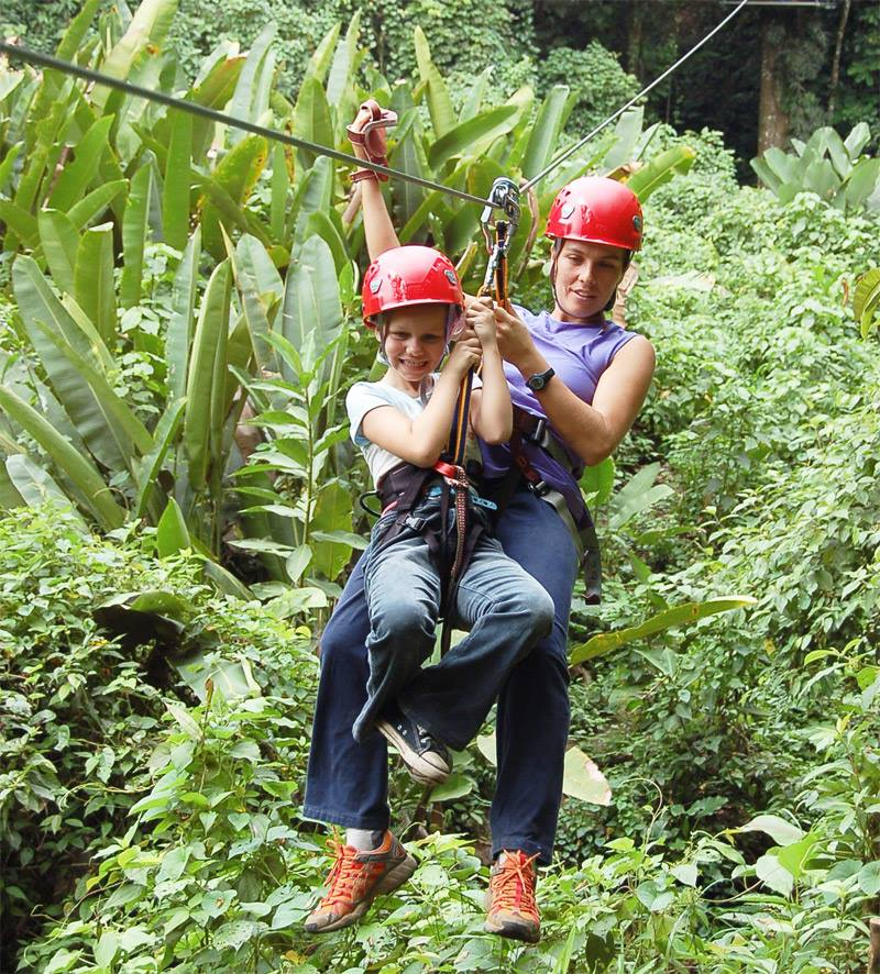 """Zip Lining - """"An adrenalin fueled adventure for the whole family"""" See the jungle from a different perspective, as you and your family join 2 certified guides on this canopy tour which which takes you high above the pristine rainforest. Few other zip lines give you the chance to truly appreciate the jungle canopy while respecting the rainforest."""