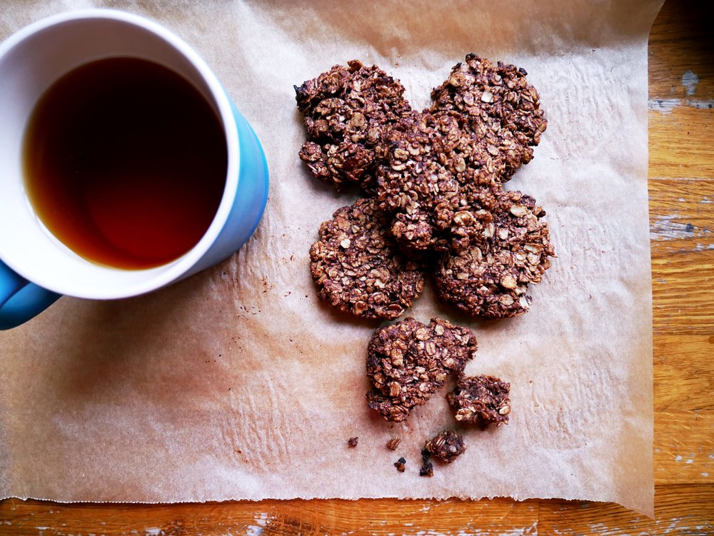 chocolate oat cookies with cup of tea