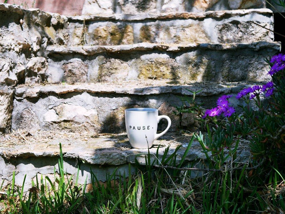 Pause mug on steps