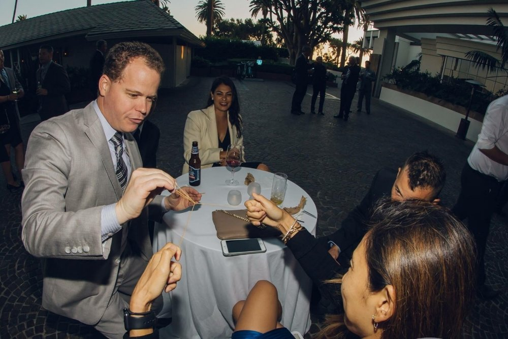 Performing magic in the hands of the audience at a corporate event