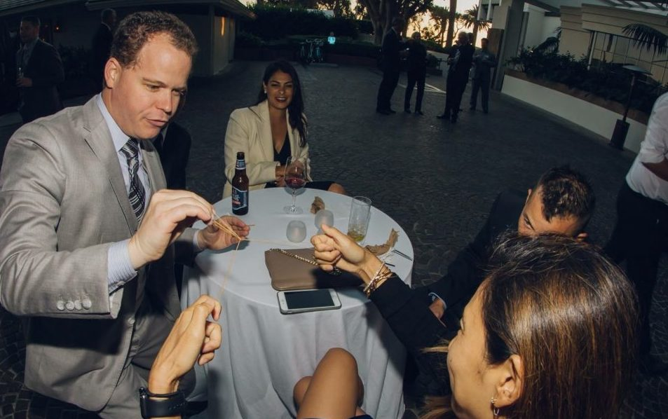 Performing magic in the hands of the audience at a corporate event.