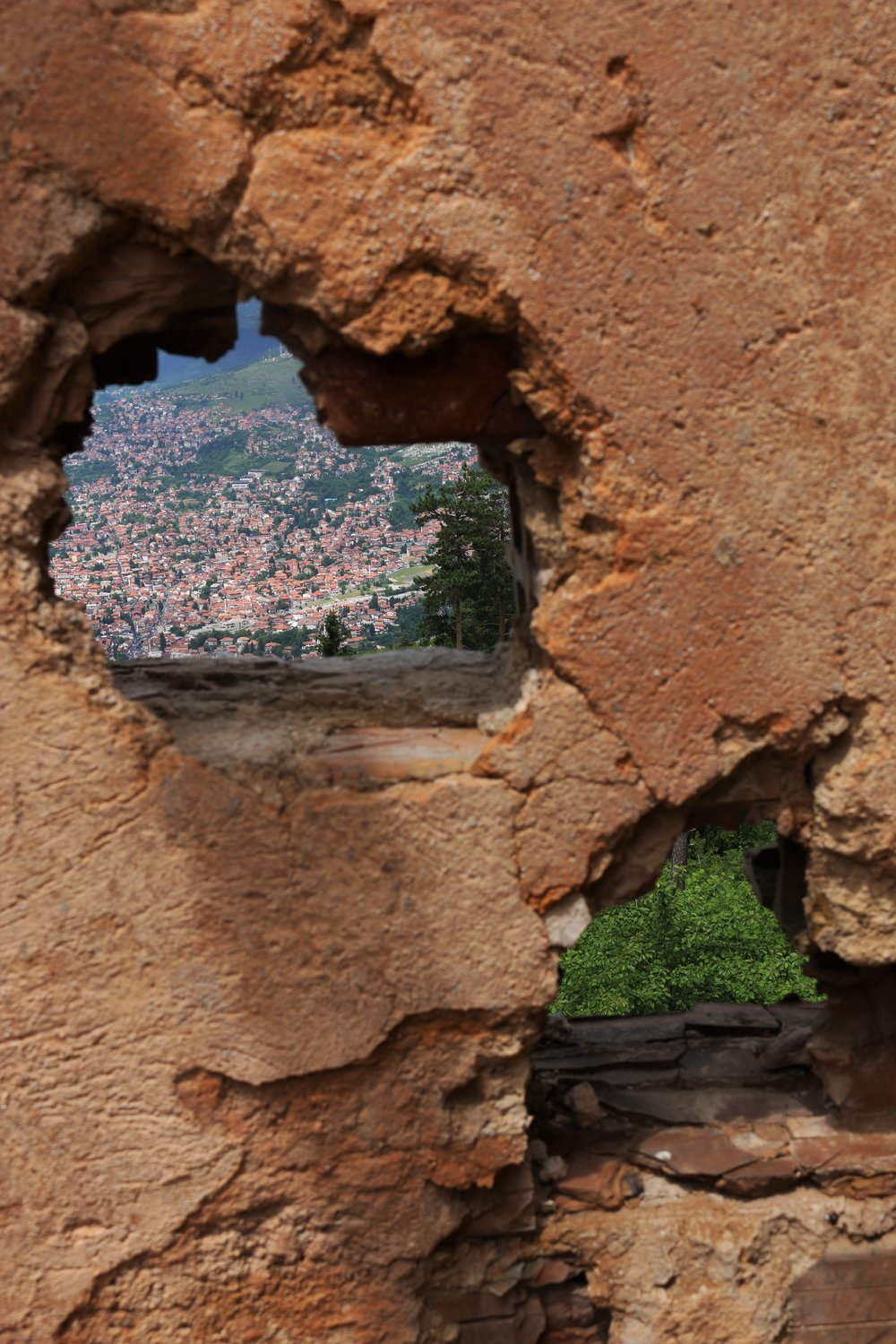 The city of Sarajevo seen through a shellhole on top of the city's destroyed observatory.