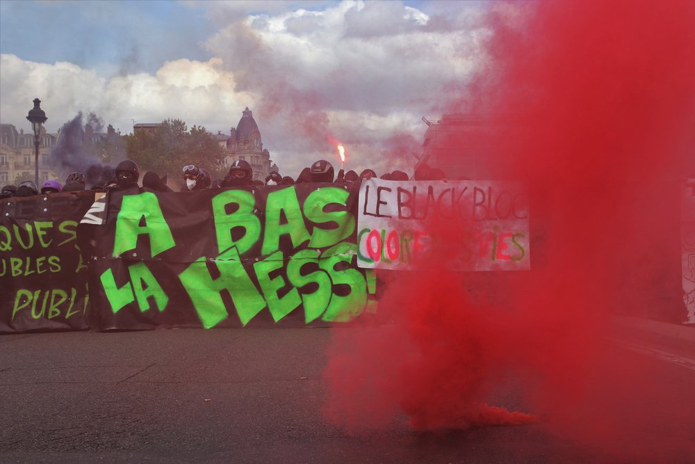 A large 'Black Bloc' contingent take to the streets of Paris during May Day demonstrations