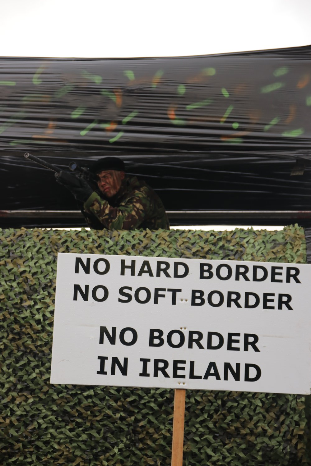 Carrickcarnan, Ireland. Mock soldiers look out over a protest taking place on the Irish border