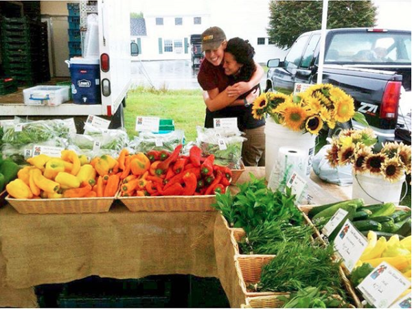 Me and a woman I'm still lucky enough to call a friend, at a farmers market in Maine, working for  Six River Farm  aka the best farm in the world I'm not biased