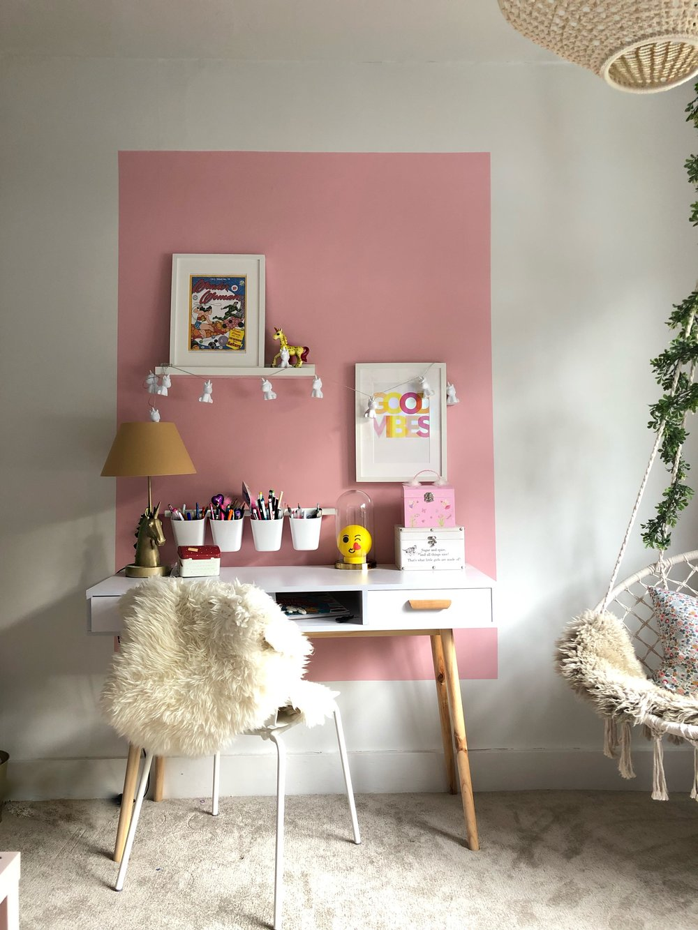 Poppy's desk area with her IKEA wall mounted storage pots, perfect for any child with over a thousand pens and pencils.