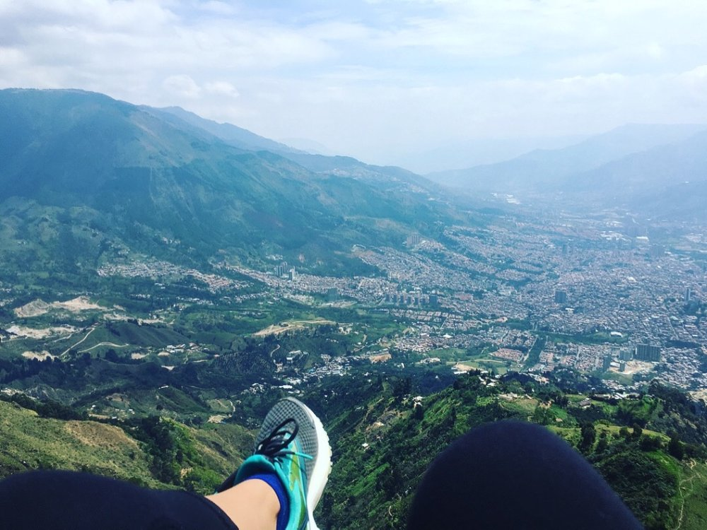 Best way to get a bird's-eye view of Medellín.  #paragliding   #birdseyeview   #medellin   #colombia   #yearoftravel   #solofemaletravel   #travelblog   #pathunwritten