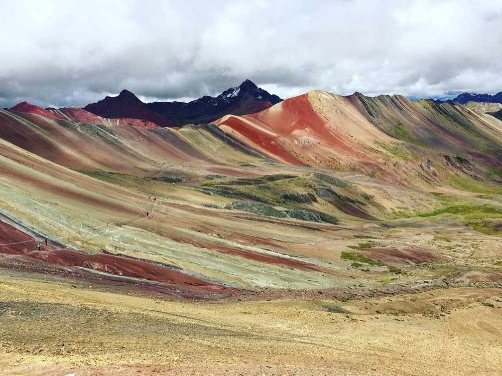 Welp, it truly is colorful! And it seems not many people are scared away by the 5,000m elevation. Absolutely stunning when the sun peeks through the clouds  #rainbowmountain   #peru   #altitudetraining   #yearoftravel   #solofemaletravel   #travelblog   #pathunwritten