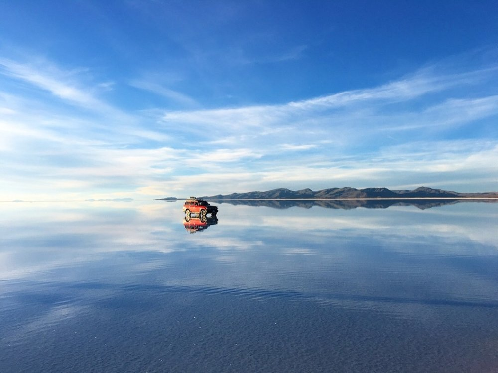 Views to make visas worthwhile. The Salar de Uyuni is truly marvelous and unbelievable  #salardeuyuni   #bolivia   #4x4offroad   #saltflats   #mirroredreflection   #naturetravel   #yearoftravel   #desertsunset   #solofemaletravel   #travelblog   #pathunwritten