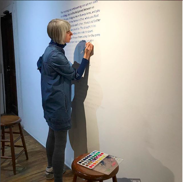 "LESLie Baum installing ""All Things Are Number"" at heaven gallery, chicago"