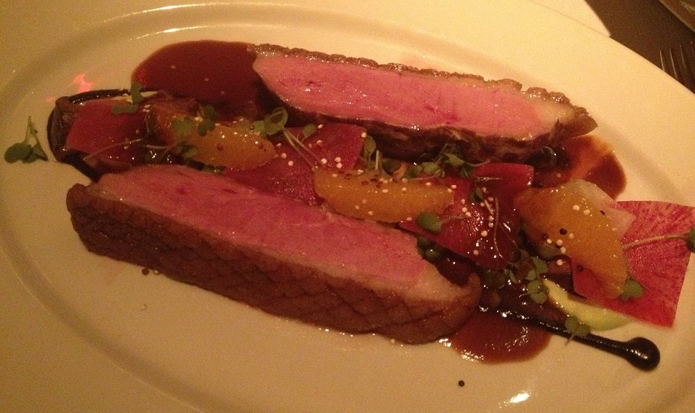 Perfectly crisp Long Island Duck with Mandarin oranges, edamame, daikon radish, and black garlic...BEST DUCK I'VE EVER TASTED!