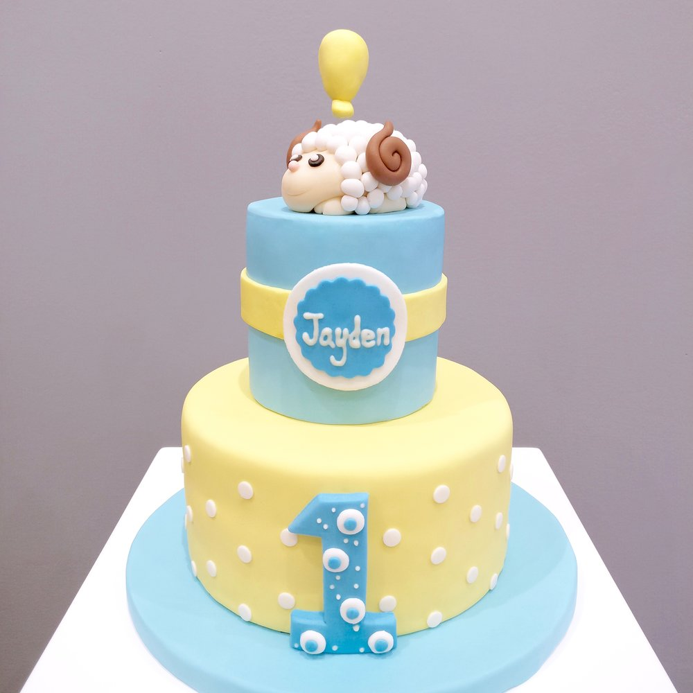 Cute first birthday fondant cake made by Gusta Cooking Studio