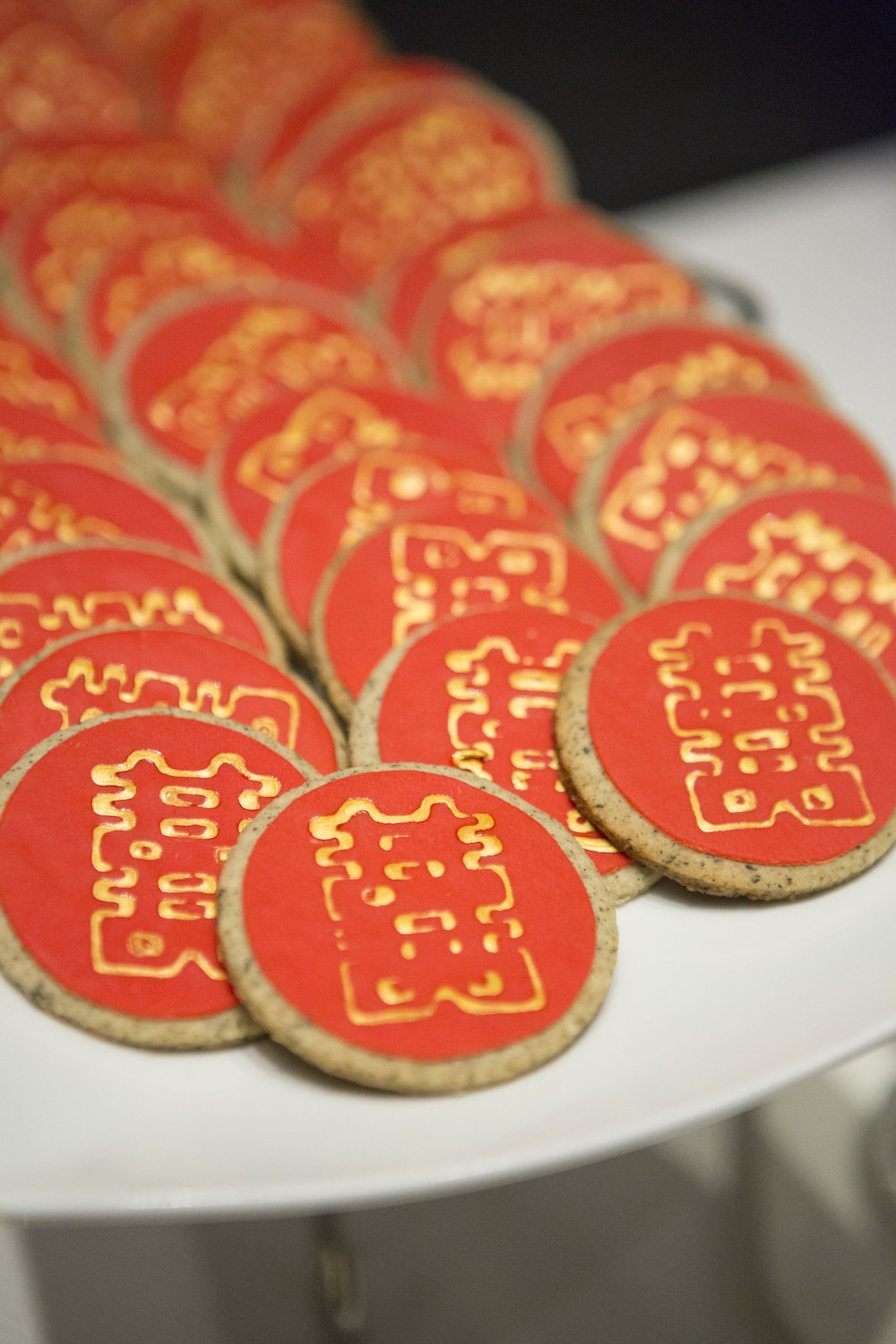 East meets west wedding cookies made by Gusta Cooking Studio