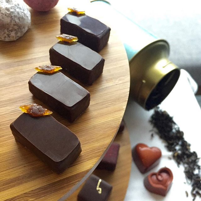 """Immerse yourself in the beauty of an afternoon tea, taking a sip at a time with dearest darlings when worldly concerns are taken care of.  Shiny orange peel reminds you of bergamot. . earl grey tea ganache 