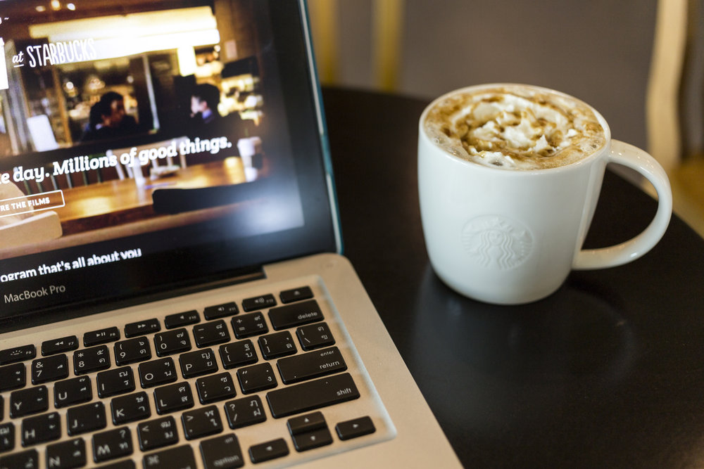 chiang-mai-thailand-october-02-2014-starbucks-coffee-caramel-latte-and-apple-laptop-open-starbucks-website-on-monitor_rvvgeXyd2Gg.jpg