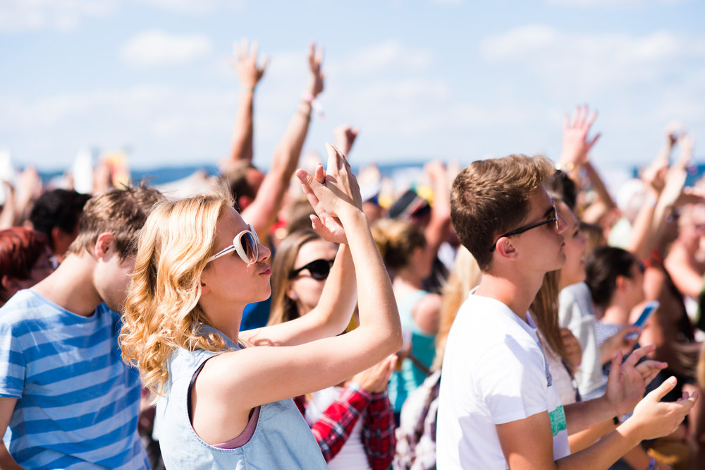 graphicstock-teenagers-at-summer-music-festival-under-the-stage-in-a-crowd-enjoying-themselves-arm-raised_rOeWijQrGZ.jpg