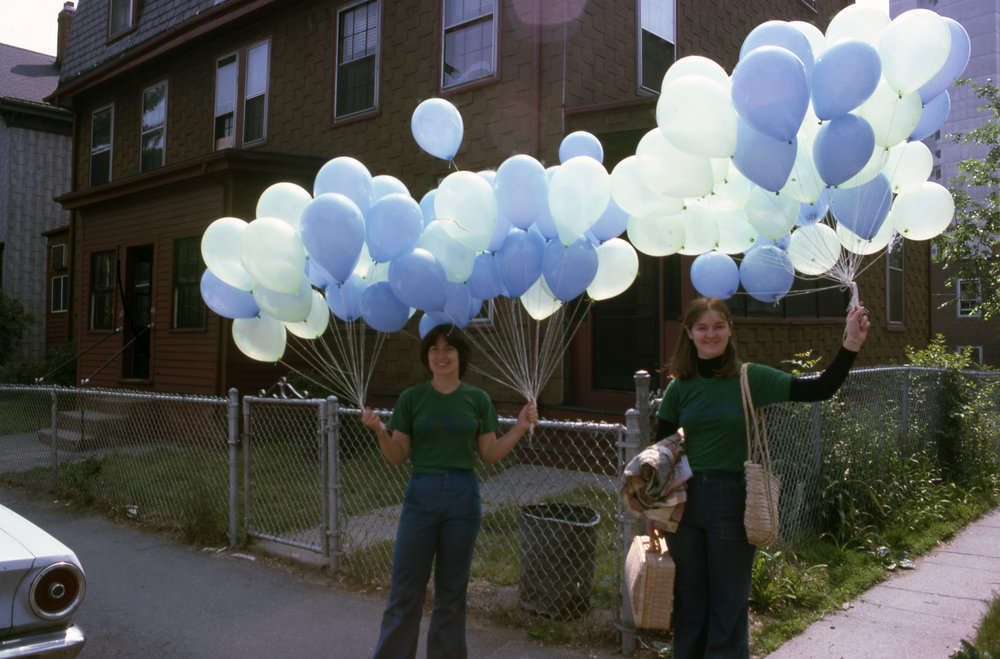 "Monica Hynes-Payack and Mary Shepherd with some of Poet Peter Payack's 5,000 ""Poetry Balloons"" at the first Cambridge River Festival in 1976. Each balloon was filled with a poem. Poems ranged from Cambridge school children to the nations Poet Laureate, Robert Pinsky."