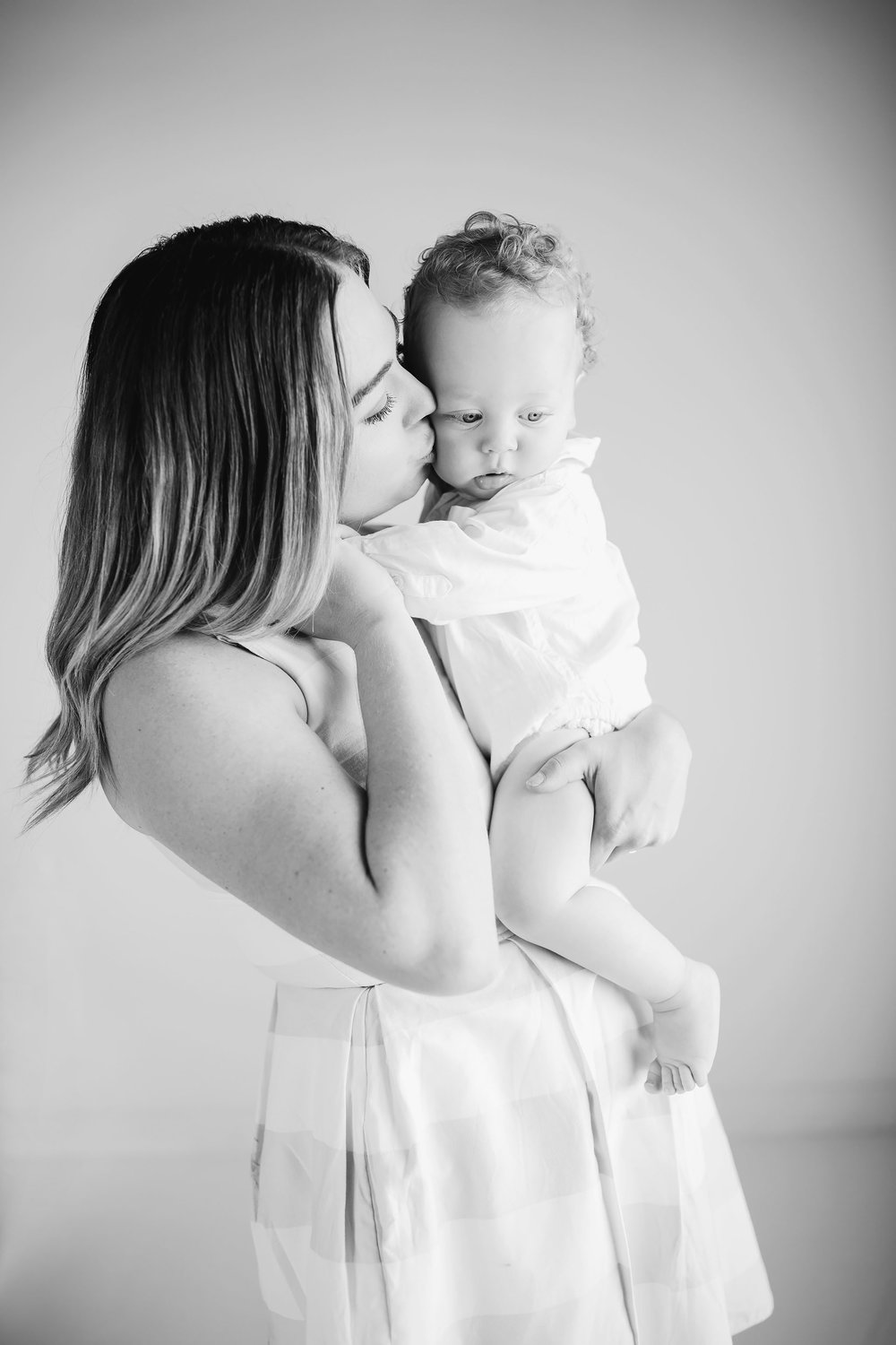 london_ontario_family_photographer-studio_photography-studio_lifestyle_portraits-white_studio-mother_son-candid_family_photography-raw_footage_photography014.jpg