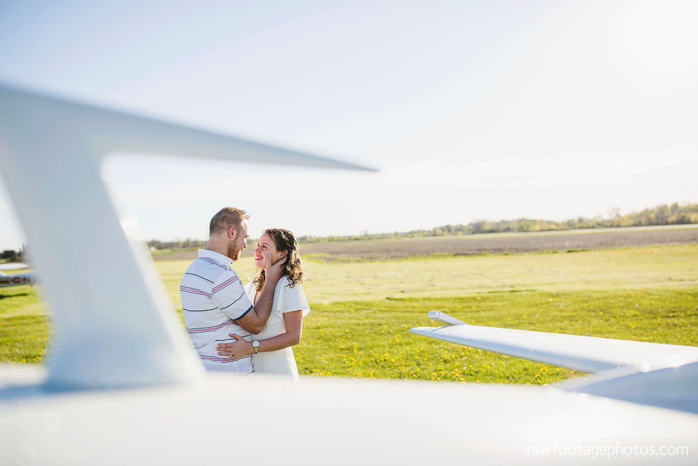 london_ontario_wedding_photographer-raw_footage_photography-engagement_session-airport_session-airplane-balloons-apple_orchard-spring_blooms-apple_blossoms005.jpg