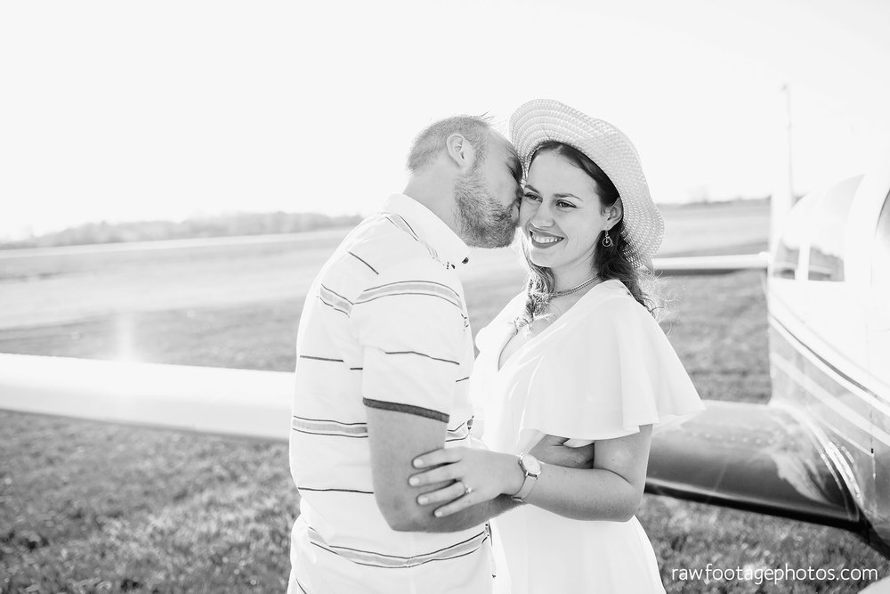 london_ontario_wedding_photographer-raw_footage_photography-engagement_session-airport_session-airplane-balloons-apple_orchard-spring_blooms-apple_blossoms008.jpg