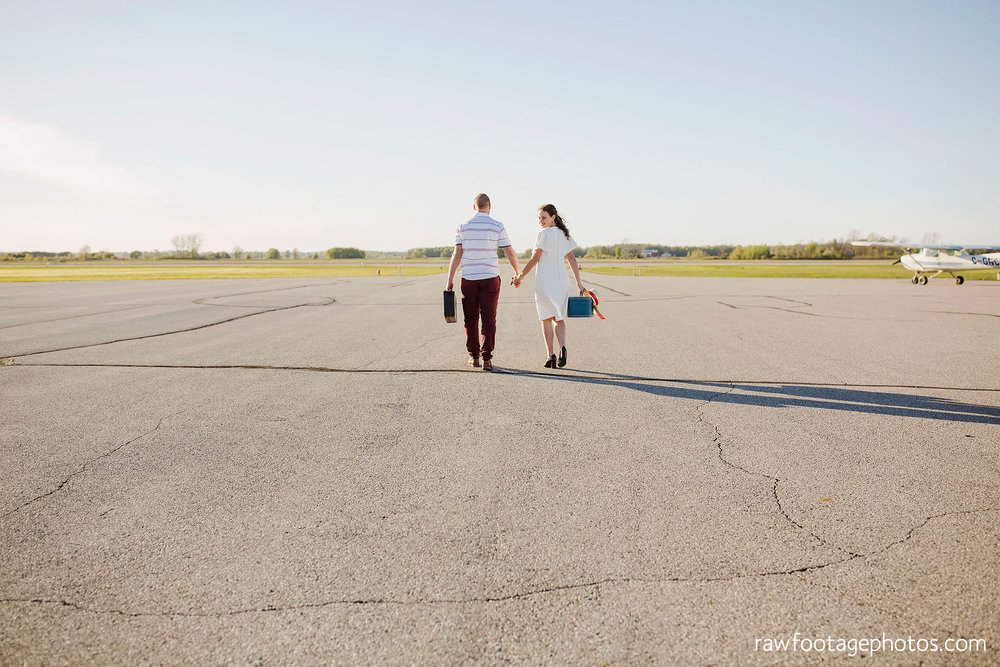 london_ontario_wedding_photographer-raw_footage_photography-engagement_session-airport_session-airplane-balloons-apple_orchard-spring_blooms-apple_blossoms011.jpg