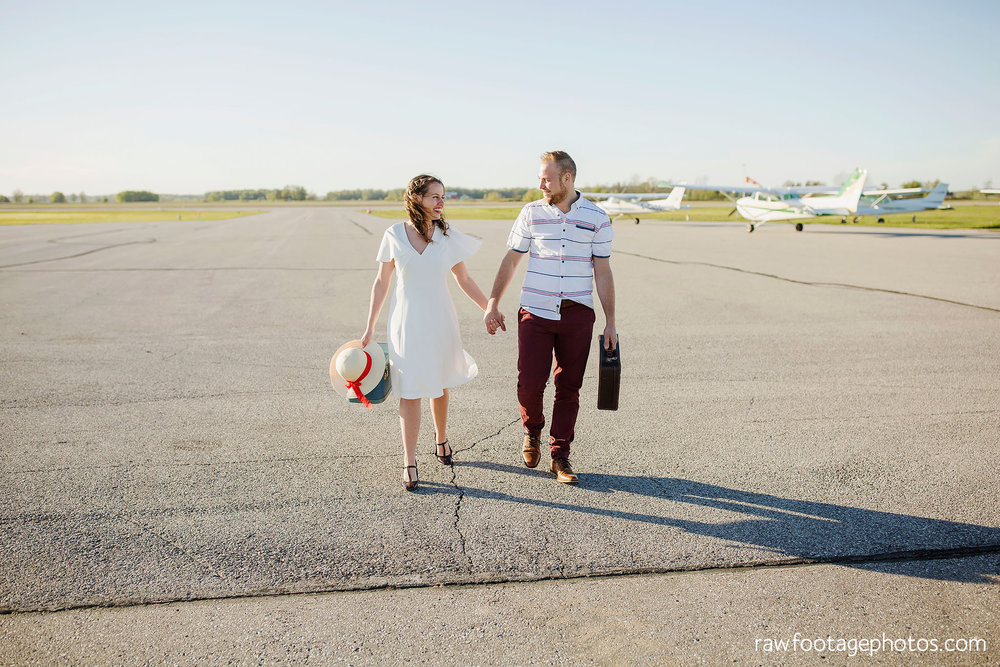 london_ontario_wedding_photographer-raw_footage_photography-engagement_session-airport_session-airplane-balloons-apple_orchard-spring_blooms-apple_blossoms012.jpg