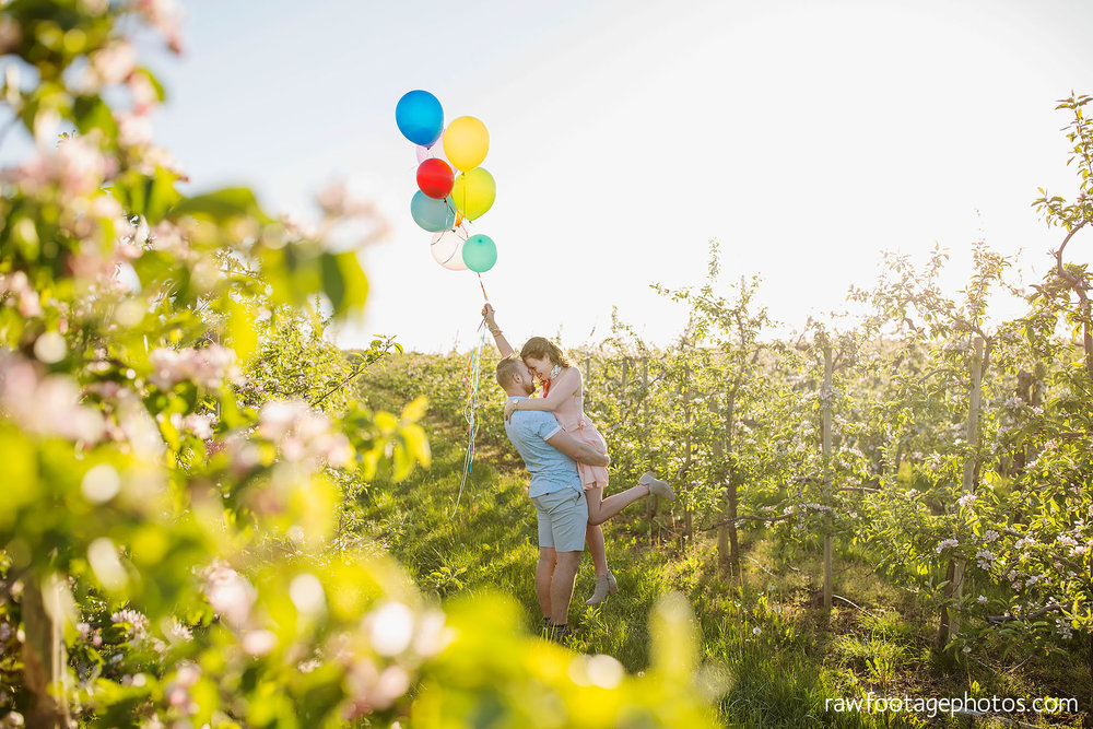 london_ontario_wedding_photographer-raw_footage_photography-engagement_session-airport_session-airplane-balloons-apple_orchard-spring_blooms-apple_blossoms013.jpg