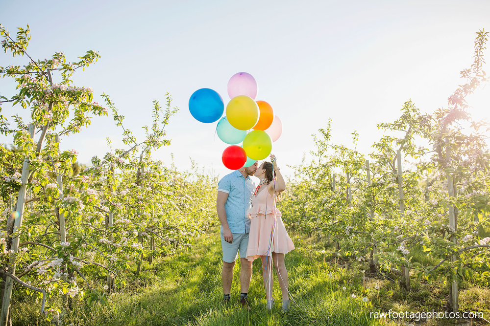 london_ontario_wedding_photographer-raw_footage_photography-engagement_session-airport_session-airplane-balloons-apple_orchard-spring_blooms-apple_blossoms016.jpg