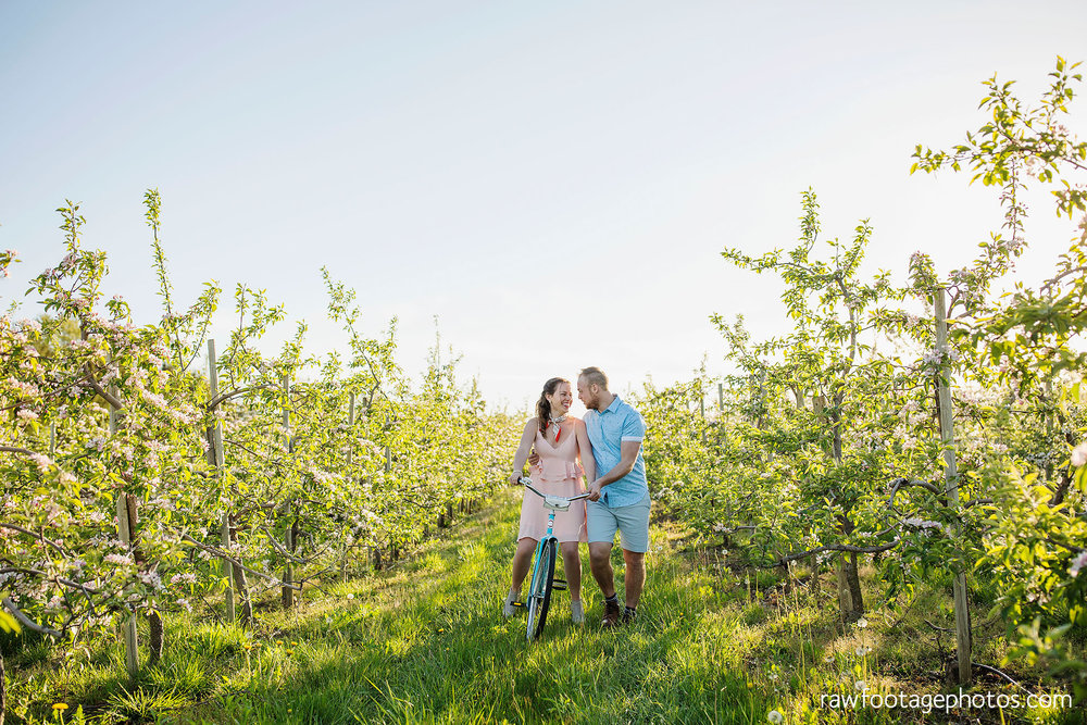 london_ontario_wedding_photographer-raw_footage_photography-engagement_session-airport_session-airplane-balloons-apple_orchard-spring_blooms-apple_blossoms017.jpg