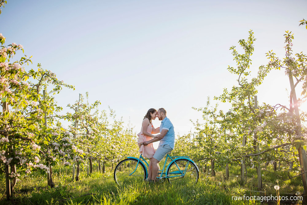 london_ontario_wedding_photographer-raw_footage_photography-engagement_session-airport_session-airplane-balloons-apple_orchard-spring_blooms-apple_blossoms019.jpg