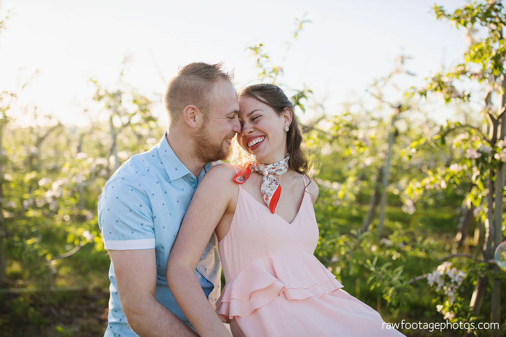 london_ontario_wedding_photographer-raw_footage_photography-engagement_session-airport_session-airplane-balloons-apple_orchard-spring_blooms-apple_blossoms021.jpg