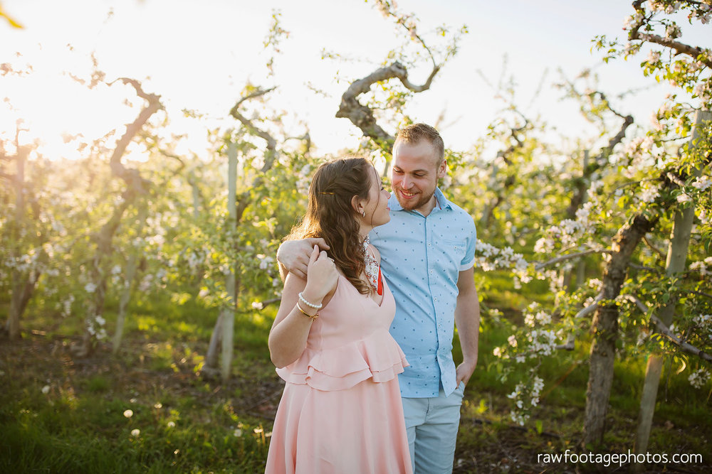 london_ontario_wedding_photographer-raw_footage_photography-engagement_session-airport_session-airplane-balloons-apple_orchard-spring_blooms-apple_blossoms027.jpg