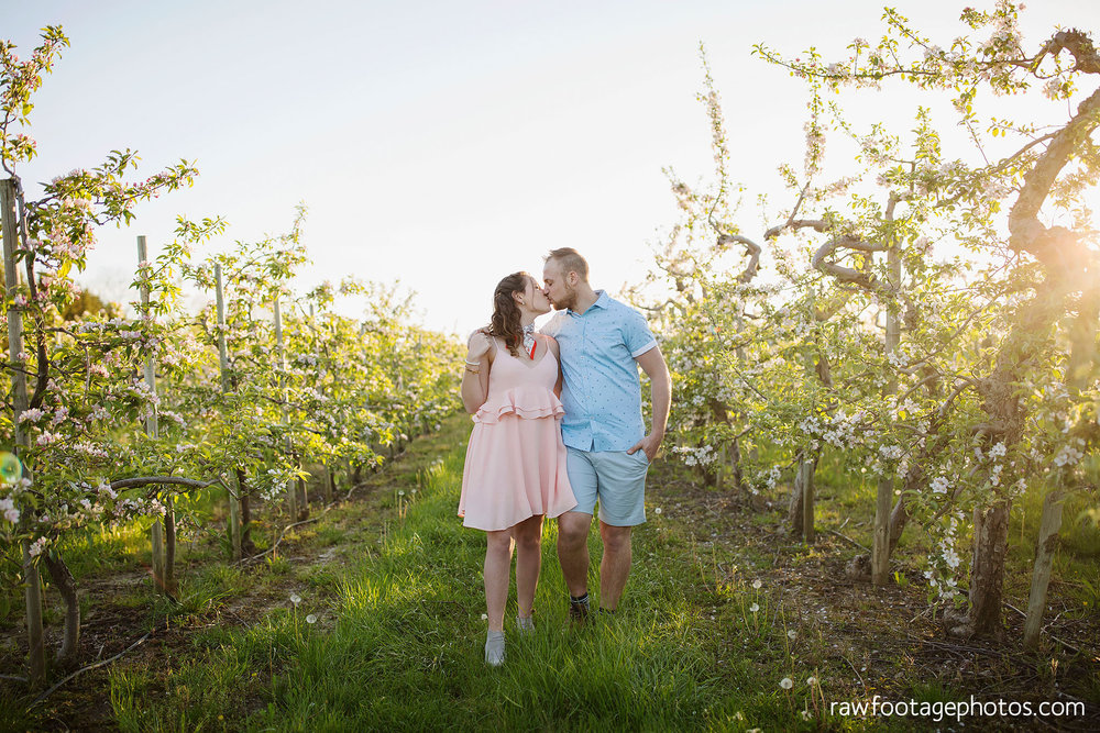 london_ontario_wedding_photographer-raw_footage_photography-engagement_session-airport_session-airplane-balloons-apple_orchard-spring_blooms-apple_blossoms026.jpg