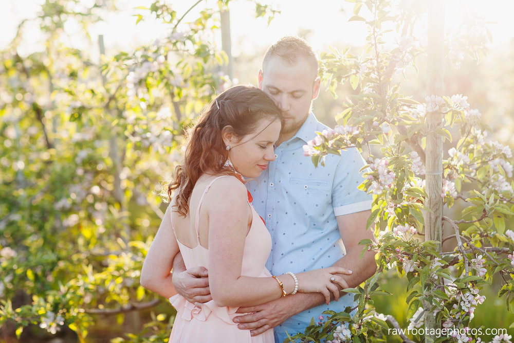 london_ontario_wedding_photographer-raw_footage_photography-engagement_session-airport_session-airplane-balloons-apple_orchard-spring_blooms-apple_blossoms034.jpg