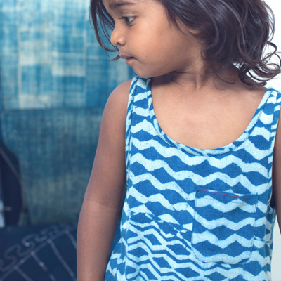 INDI KIDS - Children's clothing line that tells the stories of the artisans they work with, and the children they support through their partnership with the girl2B Foundation.