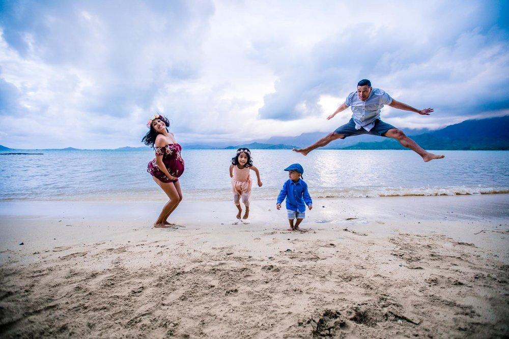 Fun family jumping at Kualoa State Park