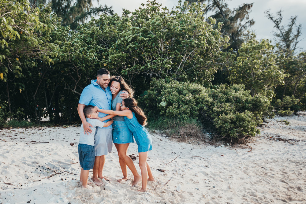 Oahu Family Photography, family hugging together on beach