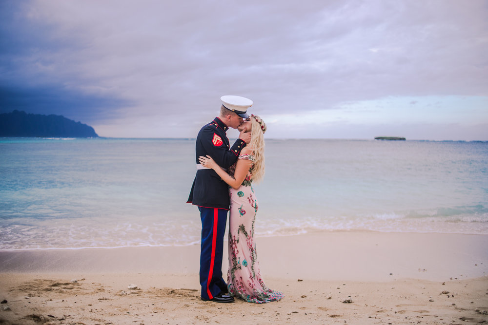 Oahu Family Photography, Marine and his significant other kissing on the sand