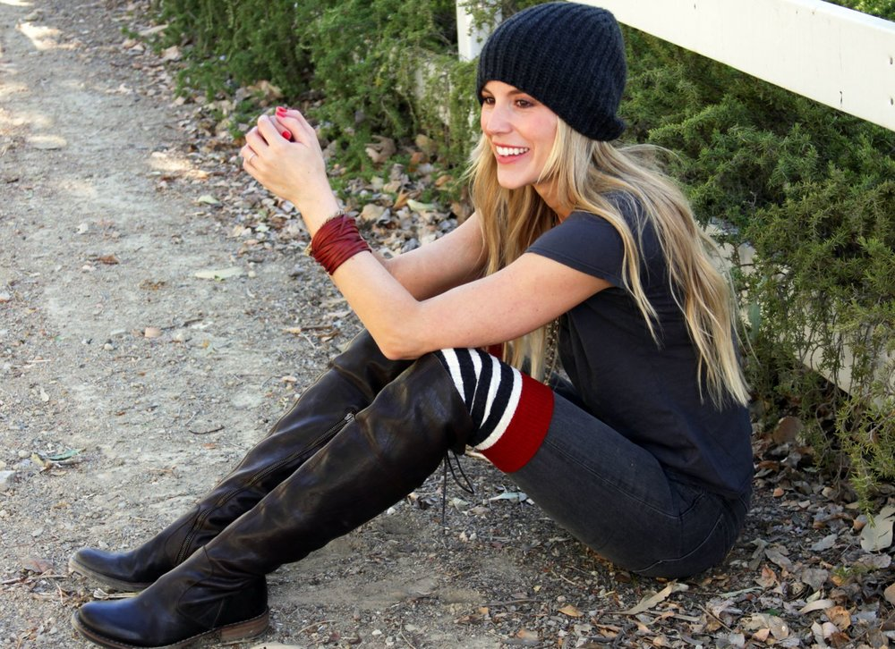 "These are the DIY sweater cuffs .... and my solo modeling shoot.  I learned in business school that one of the worst things you can do when running your own company is to micro manage every detail .... so of course I made my own boot cuffs, modeled my own boot cuffs, and set up my camera on auto and took my own modeling photo. My teacher would be so proud.  I laugh every time I look at this picture. I'm literally smiling at the fence in front of me thinking, ""My neighbors probably think I'm so weird to be laughing in the horse trail all alone with these damn sweater boot cuffs on when it's 104 today in La."" : )   Ok .... so for the tutorial."