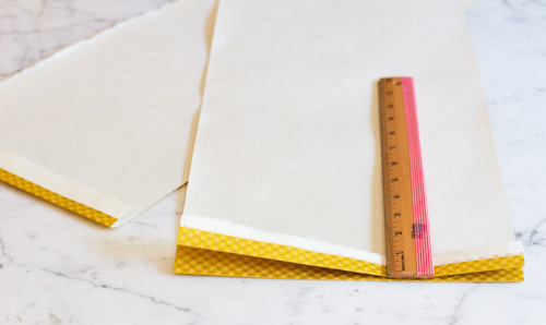 "Take each half and start fanning the paper back and forth. Each fold should be 1"" wide."