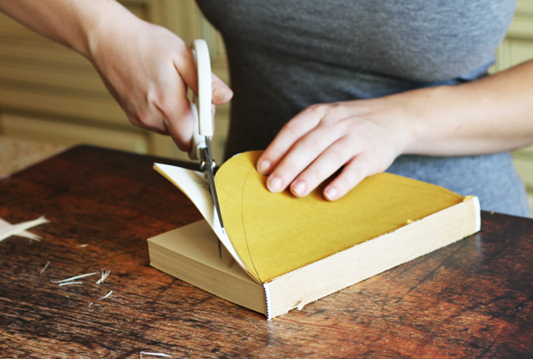 Now start cutting the rest of the pages along your half circle. You can cut multiple pages at one time so it speeds up the process.